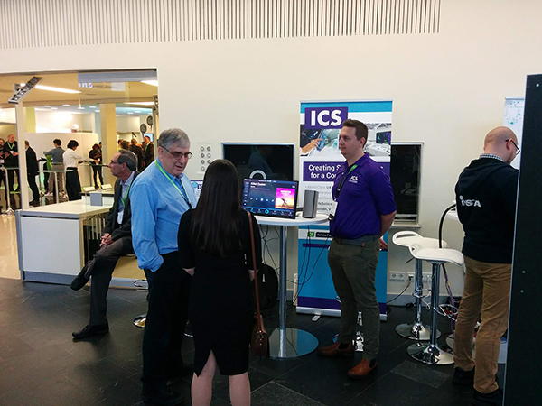 ICS CEO Peter Winston discussing design and development of embedded devices with a conference attendee.