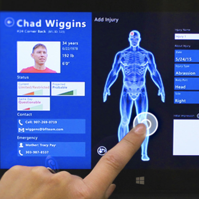 person touching medical record touch screen device