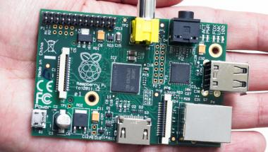 Hand holding Raspberry Pi board
